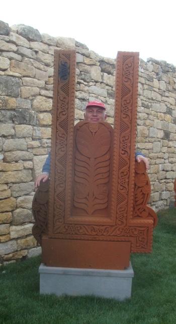 В двора са наредени   Буквите от Кирилицата- хачкари изработени от червен туф в Армения